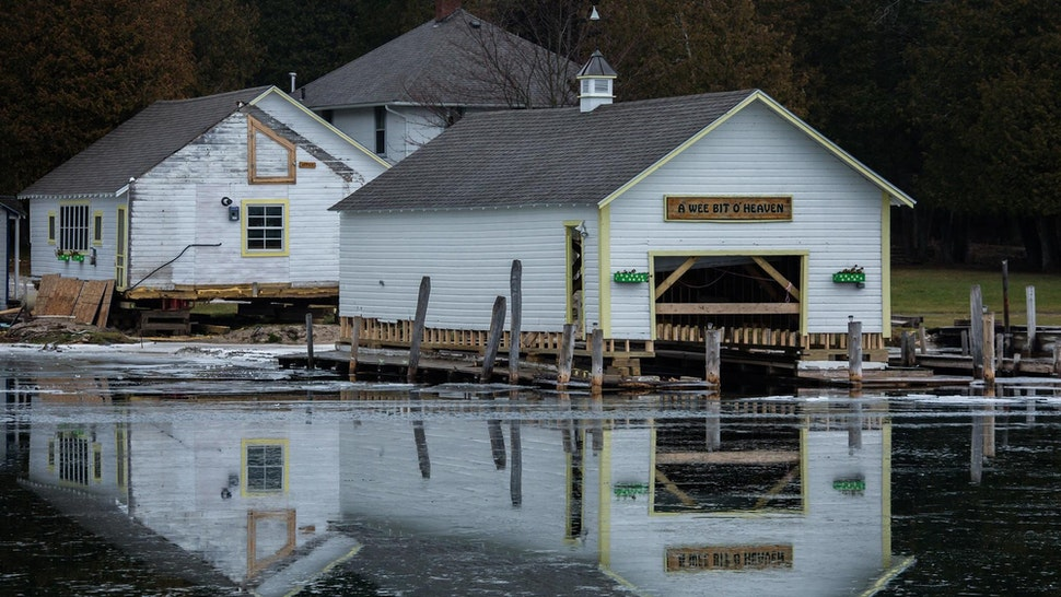 Boat houses are being removed from flooded docks in Snows Channel at Les Cheneaux Islands in the Upper Peninsula of Michigan on November 20, 2019. (Zbigniew Bzdak/Chicago Tribune/Tribune News Service via Getty Images)