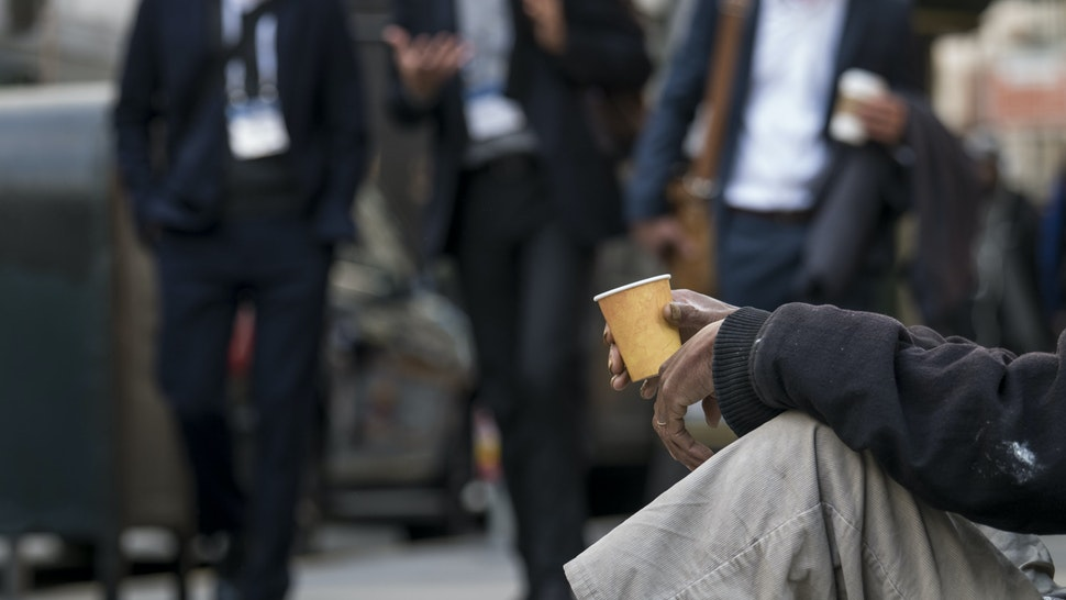 Pedestrians walk past a man holding a cup in San Francisco, California, U.S., on Monday, Jan. 13, 2020. This year's JPMorgan Healthcare Conference comes as the city is grappling with heightened attention on its troubles, with its homeless crisis worsening, tech companies facing backlash and President Donald Trumplashing outat California's policies. Photographer: David Paul Morris/Bloomberg via Getty Images