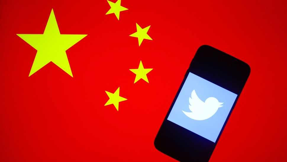 witter logo is displayed on a mobile phone screen photographed on the People's Republic of China national flag background arranged for illustration photo taken in Krakow, Poland on 15th January, 2020. (Photo illustration by Beata Zawrzel/NurPhoto via Getty Images)