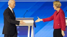 Former U.S. Vice President Joe Biden, 2020 Democratic presidential candidate, left, prepares to shake hands with Senator Elizabeth Warren, a Democrat from Massachusetts, ahead of the Democratic presidential debate at Saint Anselm College in Manchester, New Hampshire, U.S., on Friday, Feb. 7, 2020.
