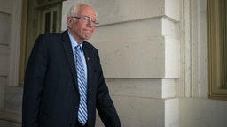 Senator Bernie Sanders, an Independent from Vermont and 2020 presidential candidate, exits the U.S. Capitol after a vote in Washington, D.C., U.S., on Wednesday, March 18, 2020. The Senate cleared the second major bill responding to the coronavirus pandemic, with lawmakers rushing to follow up with an additional economic rescue package that President Donald Trump's administration estimates will cost $1.3 trillion. Photographer: Al Drago/Bloomberg via Getty Images