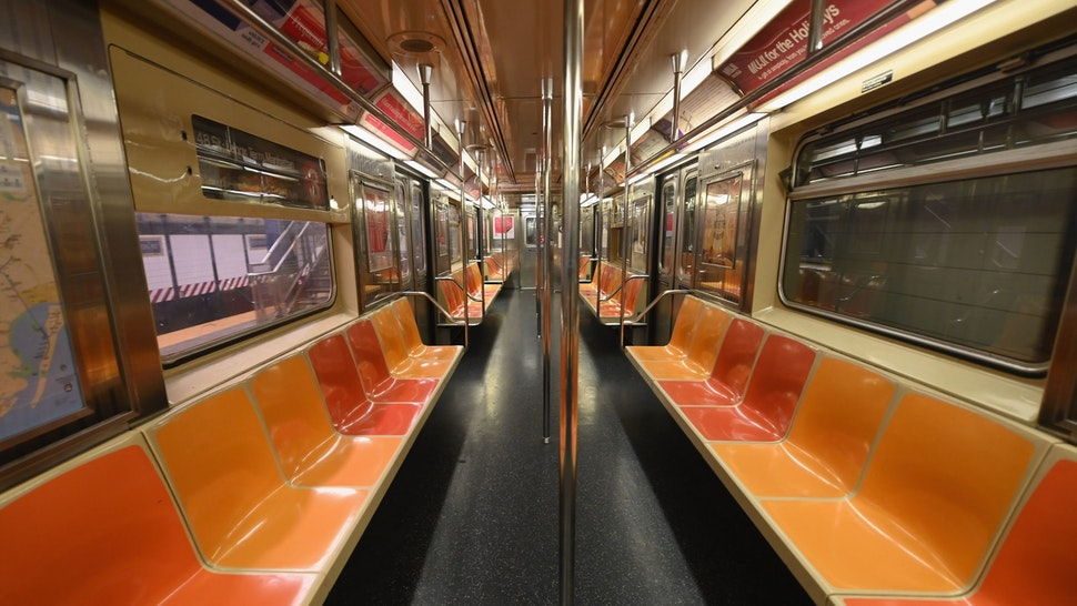 TOPSHOT - An empty New York Subway car is seen on March 23, 2020 in New York City. - Wall Street fell early March 23, 2020 as Congress wrangled over a massive stimulus package while the Federal Reserve unveiled new emergency programs to boost the economy including with unlimited bond buying. About 45 minutes into trading, the Dow Jones Industrial Average was down 0.6 percent at 19,053.17, and the broad-based S&P 500 also fell 0.6 percent to 2,290.31 after regaining some ground lost just after the open. (Photo by Angela Weiss / AFP) (Photo by ANGELA WEISS/AFP via Getty Image