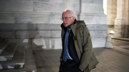 Senator Bernie Sanders, an Independent from Vermont and 2020 presidential candidate, departs the U.S. Capitol following a vote in Washington, D.C., U.S., on Wednesday, March 25, 2020. The U.S. Senate approved a historic $2 trillion rescue plan to respond to the economic and health crisis caused by the coronavirus pandemic, putting pressure on the Democratic-led House to pass the bill quickly and send it to President Donald Trump for his signature. Photographer: Al Drago/Bloomberg via Getty Images