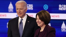 CHARLESTON, SOUTH CAROLINA - FEBRUARY 25: Democratic presidential candidates former Vice President Joe Biden and Sen. Amy Klobuchar (D-MN) interact during a break at the Democratic presidential primary debate at the Charleston Gaillard Center on February 25, 2020 in Charleston, South Carolina. Seven candidates qualified for the debate, hosted by CBS News and Congressional Black Caucus Institute, ahead of South Carolina's primary in four days. (Photo by Win McNamee/Getty Images)