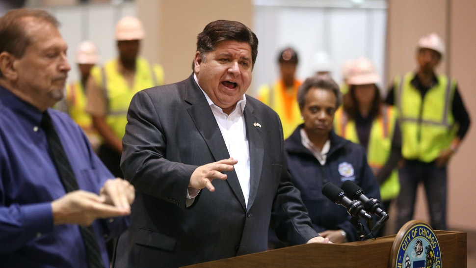 CHICAGO, IL - APRIL 3: Chicago Mayor Lori Lightfoot stands by as Illinois Gov. J.B. Pritzker speaks during a press conference in Hall C Unit 1 of the COVID-19 alternate site at McCormick Place on Friday, April 3, 2020 in Chicago, Illinois. Gov. Pritzker And Mayor Lightfoot toured what will be a 3,000-bed medical facility to treat less seriously-ill COVID-19 patients built in a collaborative effort involving the Illinois National Guard, U.S. Army Corps of Engineers and trade unions. (Photo by Chris Sweda-Pool via Getty Images)
