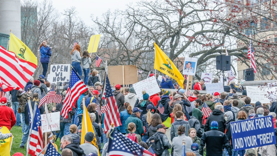 """At a """"Rally to Reopen Wisconsin"""", """"Safer at Home"""" protesters demonstrate against measures enacted to mitigate the Coronavirus on April 24, 2020 at the Wisconsin state Capitol in Madison, Wisconsin."""