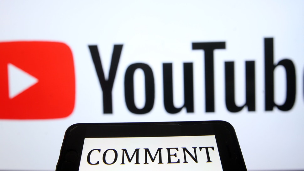 "ANKARA, TURKEY - APRIL 28: YouTube logo is being displayed behind a text reading ""comment"" on a smart phone screen in Ankara, Turkey on April 28, 2020. Evrim Aydın / Anadolu Agency"