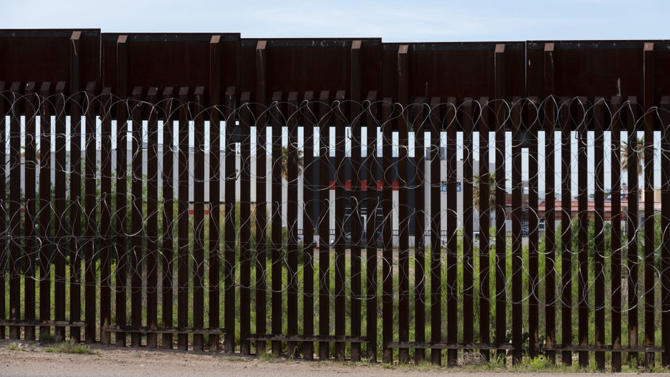 The Standex Electronics manufacturing facility in Agua Prieta, Sonora state, Mexico, is seen through the border fence from Douglas, Arizona, U.S., on Monday, April 27, 2020.