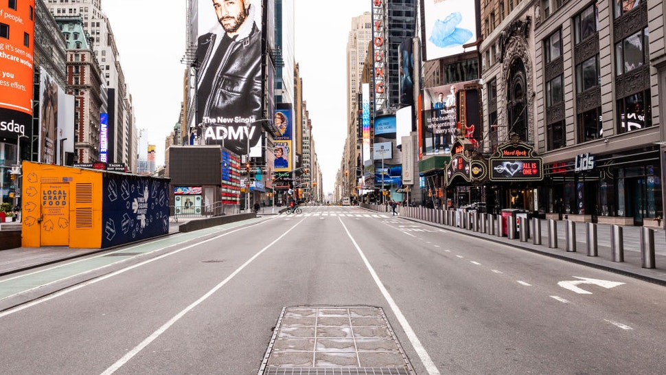 An empty and deserted street at New York City's Times Square during the covid 19 pandemic.-