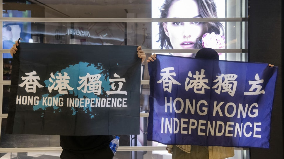 Protesters gathered at New Town Plaza shopping mall, in Hong Kong, China on May 1, 2020. As virus cases eased in Hong Kong, activities threated Government social-distancing restrictions with a new protest in Shatin which was quickly dispersed by hundreds of riot police officers.