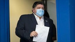 Illinois Gov. J.B. Pritzker arrives in a mask to speak April 19, 2020, at the Thompson Center during the coronavirus pandemic. (Brian Cassella/Chicago Tribune/Tribune News Service via Getty Images)
