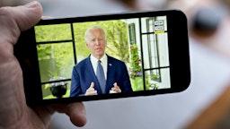 Former Vice President Joe Biden, presumptive Democratic presidential nominee, speaks during a NowThis economic address seen on a smartphone in Arlington, Virginia, U.S., on Friday, May 8, 2020.