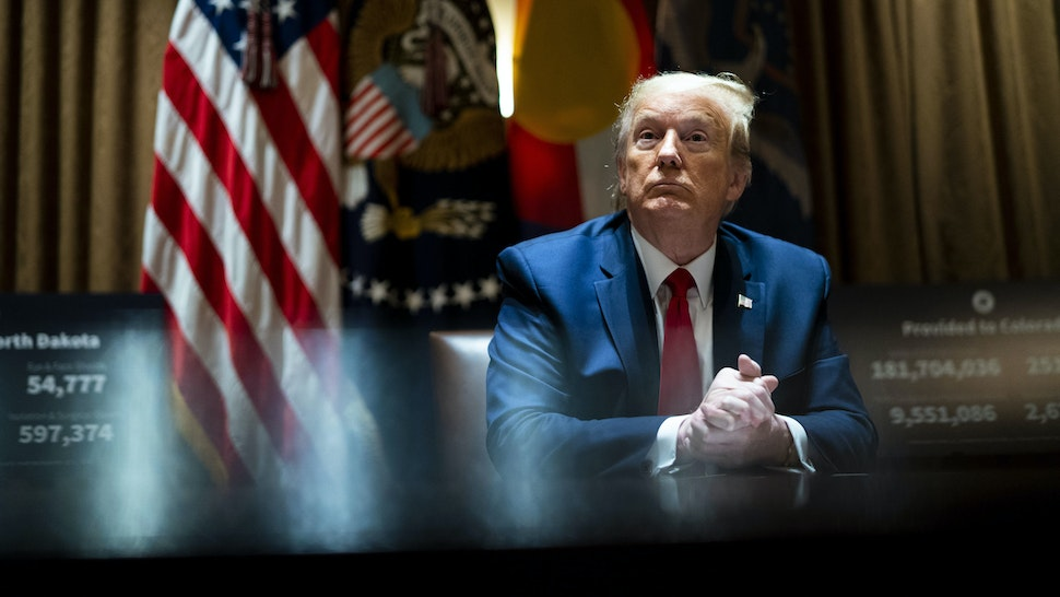 WASHINGTON, DC - MAY 13: U.S. President Donald Trump looks on he as meets with Colorado Governor Jared Polis and North Dakota Governor Doug Burgum in the Cabinet Room of the White House on May 13, 2020 in Washington, DC. (Photo by Doug Mills-Pool/Getty Images)