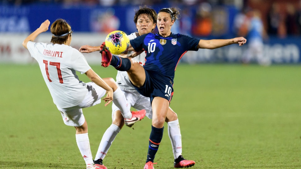 Carli Lloyd #10 of the United States reaches out to gain control of a loose ball with Moeka Minami #5 and Narumi Miura #17 of Japan on either side of her during a game between Japan and USWNT at Toyota Stadium on March 11, 2020 in Frisco, Texas.