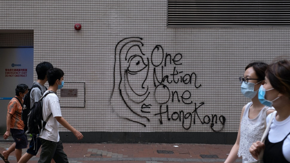 "Graffiti reading ""One Nation, One Hong Kong"" is marked on a wall during a protest against a planned national security law in the Causeway Bay district in Hong Kong, China, on Sunday, May 24, 2020. Almost 200 politicians and legislators from 23 countries issued a joint statement criticizing Chinas plans to impose a sweeping national security law in Hong Kong, and warned that it could spark more protests in the city, Radio and Television Hong Kong reported. Photographer: Roy Liu/Bloomberg via Getty Images"