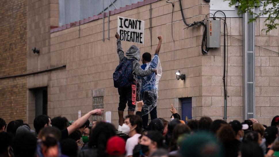 Protesters demonstrate against the death of George Floyd outside the 3rd Precinct Police Precinct on May 26, 2020 in Minneapolis, Minnesota.