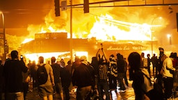 Protestors set a shop on fire on Thursday, May 28, 2020, during the third day of protests over the death of George Floyd in Minneapolis.