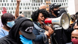 Jamela J. Pettiford sings during a protest with Former NBA player Stephen Jackson in response to the police killing of George Floyd outside the Hennepin County Government Center on May 29, 2020 in Minneapolis, Minnesota.