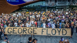 Protesters holding a giant banner reading GEORGE FLOYD outside the Barclays Center. Hundreds of protesters made their way toward Barclays Center in Brooklyn to demonstrate against police brutality in the wake of George Floyd's death while in police custody in Minneapolis.