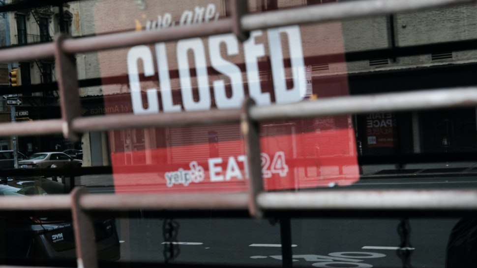 NEW YORK CITY - APRIL 17: A closed sign is displayed in the window of a business in a nearly deserted lower Manhattan on April 17, 2020 in New York City, United States. New York City has been the hardest hit city in America from COVIT-19, with overwhelmed hospitals and a struggling economy.