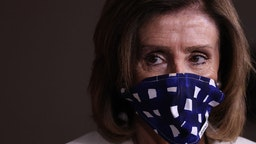 Speaker of the House Nancy Pelosi (D-CA) wears a cloth mask to cover her mouth and nose to prevent the spread of the novel coronavirus during her weekly news conference at the U.S. Capitol April 30, 2020 in Washington, DC.