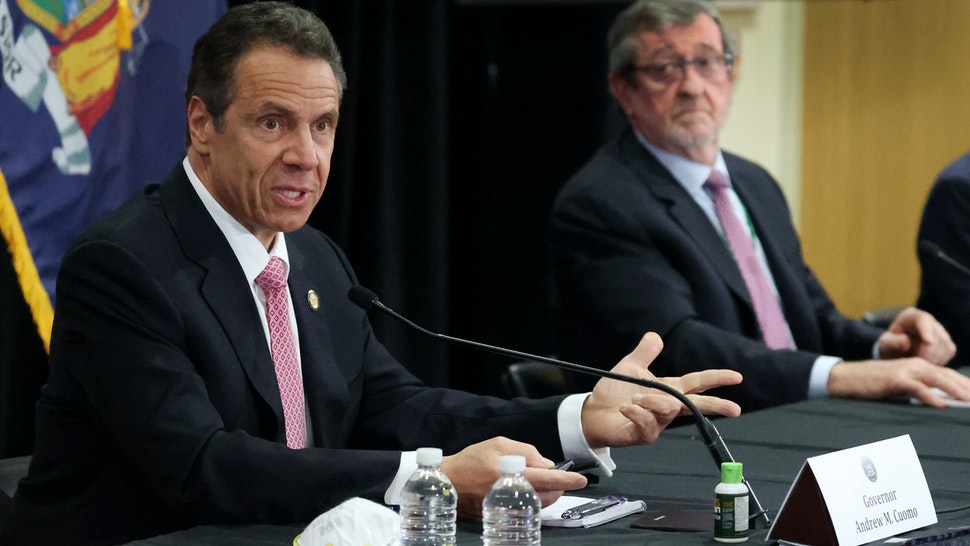 MANHASSET, NEW YORK - MAY 06: New York Governor Andrew Cuomo speaks while President and CEO of Northwell Health Michael Dowling looks on during a Coronavirus Briefing At Northwell Feinstein Institute For Medical Research on May 06, 2020 in Manhasset, New York. (Photo by Al Bello/Getty Images)