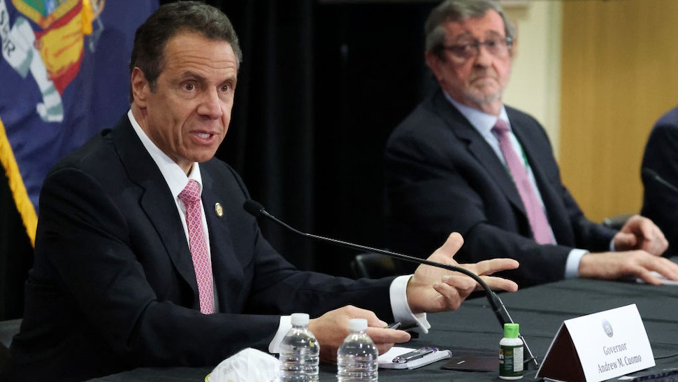 New York Governor Andrew Cuomo speaks while President and CEO of Northwell Health Michael Dowling looks on during a Coronavirus Briefing At Northwell Feinstein Institute For Medical Research on May 06, 2020 in Manhasset, New York.