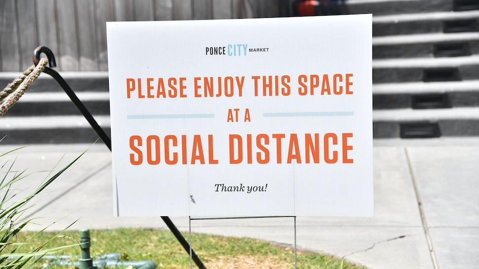 """ATLANTA, GEORGIA - MAY 10: A sign displays """"Please Enjoy This Space At Social Distance"""" at the Atlanta Beltline as the coronavirus pandemic continues on May 10, 2020 in Atlanta, Georgia. There are currently over 32,000 confirmed COVID-19 cases in Georgia. (Photo by Paras Griffin/Getty Images)"""