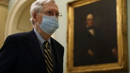 WASHINGTON, DC - MAY 11: U.S. Senate Majority Leader Sen. Mitch McConnell (R-KY) wears a mask as he walks through a hallway at the U.S. Capitol May 11, 2020 in Washington, DC. The Senate is back in session for the second week after a pause due to the COVID-19 outbreak. (Photo by Alex Wong/Getty Images)WASHINGTON, DC - MAY 11: U.S. Senate Majority Leader Sen. Mitch McConnell (R-KY) wears a mask as he walks through a hallway at the U.S. Capitol May 11, 2020 in Washington, DC. The Senate is back in session for the second week after a pause due to the COVID-19 outbreak. (Photo by Alex Wong/Getty Images)