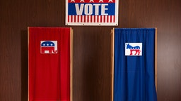 Voting booths in polling place - stock photo