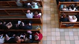 Congregation at church praying - stock photo