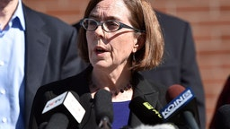 Oregon Governor Kate Brown reacts during a press conference in Roseburg, Oregon on October 2, 2015.