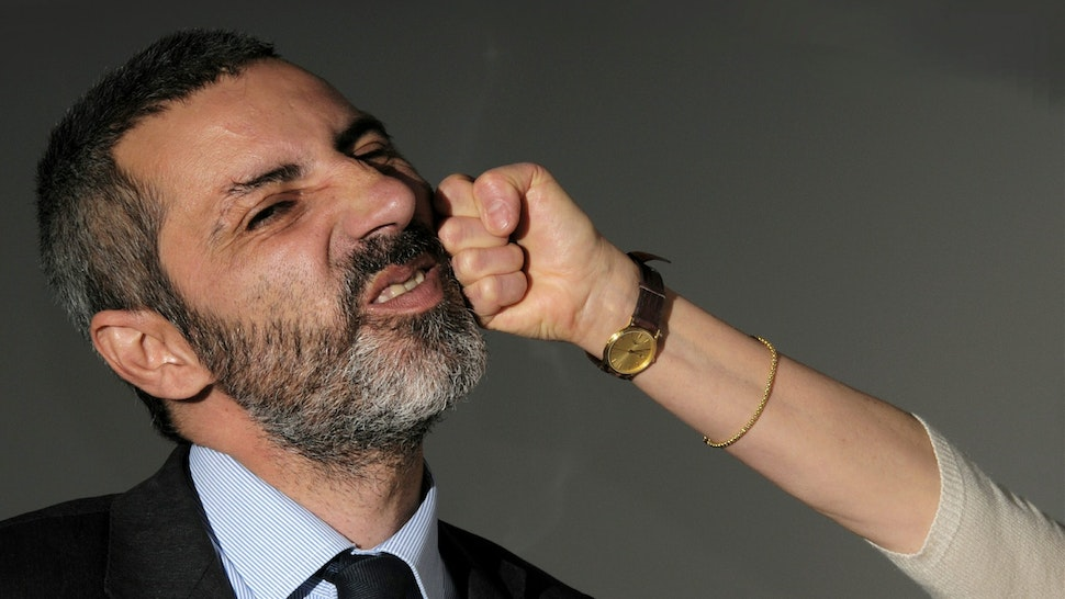 Cropped Image Of Woman Punching Businessman At Home - stock photo