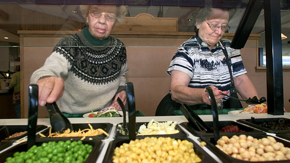 June Ross, left, from Lancaster, and friend Barbara Murray, from Victorville, fill their plates up while visiting the salad bar at Souplantation in Camarillo. Digital image taken on 05/09/03