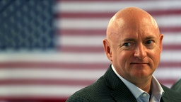 Retired NASA astronaut Mark Kelly waits to speak during a press conference where he joined his wife, former Rep. Gabrielle Giffords, and other anti-gun violence activists and victims' families to discuss the impact of gun violence on August 12, 2016 in Miami, Florida.