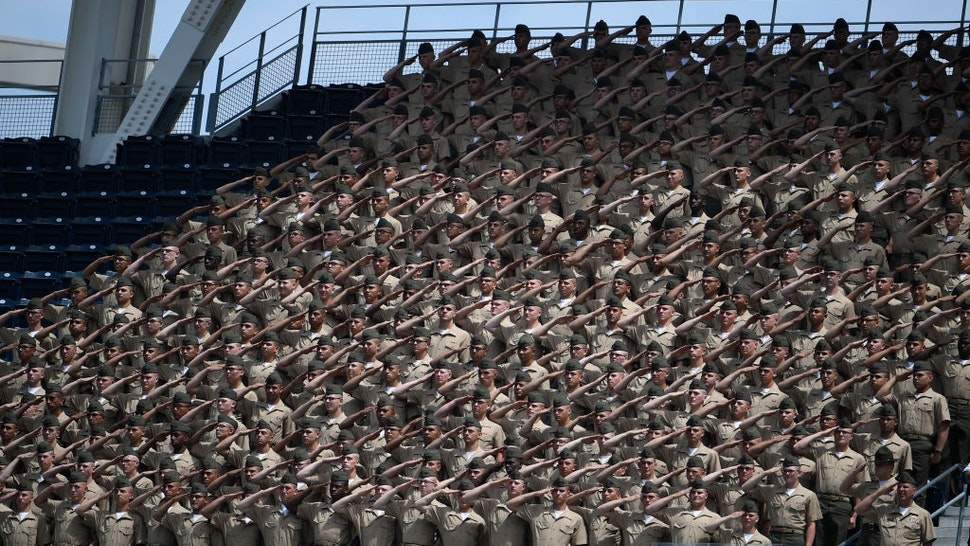 U.S. Marine Corps recruits salute before a baseball game between San Francisco Giants and San Diego Padres at PETCO Park as part of Military Opening Day on April 9, 2017 in San Diego, California.