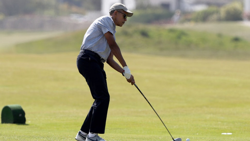 Former US President Barack Obama during a round of golf on the Old Course at St Andrews during a Visit to Scotland