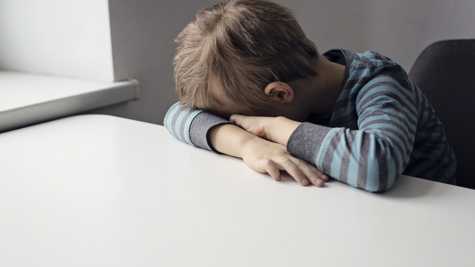 boy covering face