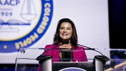 Gretchen Whitmer, governor of Michigan, smile while speaking during the 110th NAACP Annual Convention in Detroit, Michigan, U.S., on Monday, July 22, 2019. Democrats are launching a campaign in seven battleground states to make the case against Donald Trump's economy, seeking to neutralize the president's strongest political asset as his re-election campaign heats up. Photographer: Anthony Lanzilote/Bloomberg via Getty Images