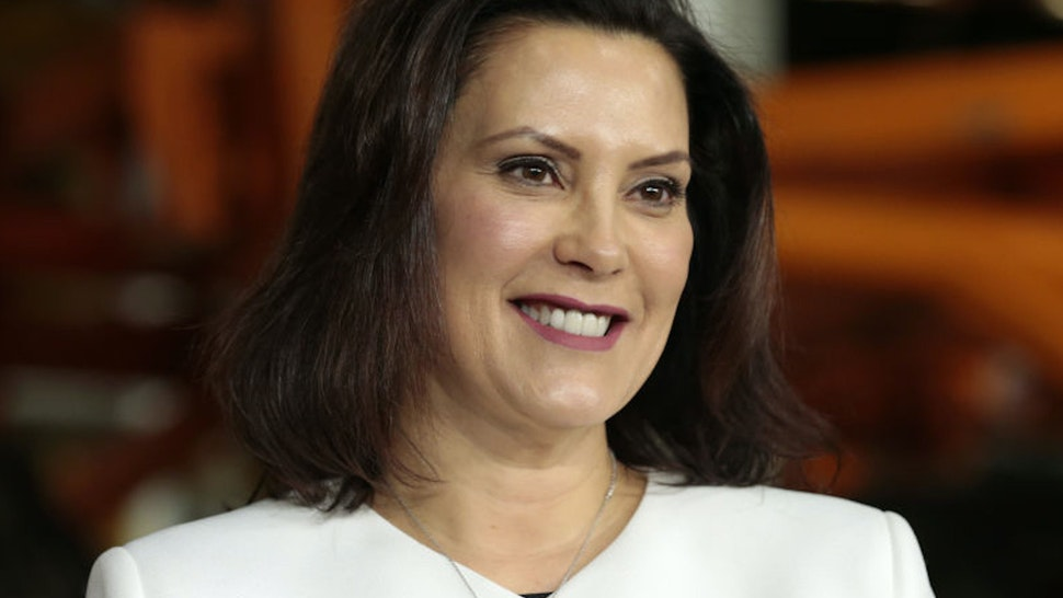 Gretchen Whitmer, governor of Michigan, smiles during an event at the General Motors Co. Orion Assembly plant in Orion Township, Michigan, U.S., on Friday, March 22, 2019. General Motors Co.committed to investing $1.8 billion at plants in six states and to creating 700 new jobs, as the largest U.S. automaker looks to ward offmonths of criticismby PresidentDonald Trump