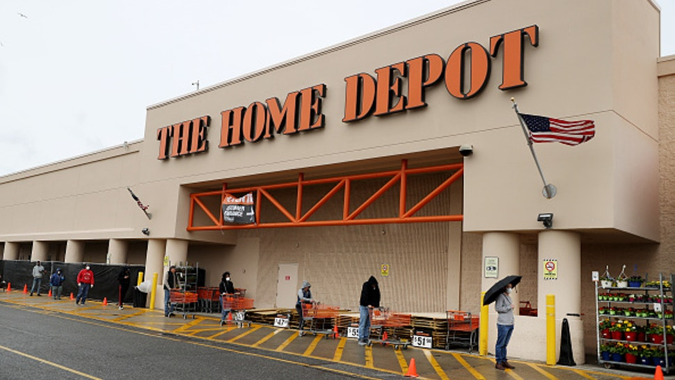 FREEPORT, NEW YORK - APRIL 03: People wearing masks and gloves wait to enter Home Depot on April 03, 2020 in Freeport, New York. Due to the coronavirus (COVID-19) pandemic Home Depot implemented social distancing while shopping in the store by letting only a certain number of people enter at a time. The World Health Organization declared coronavirus (COVID-19) a global pandemic on March 11th.