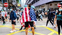 One Hong Kong street protester is draped with the United States of America flag during the 24th May protests in the Causeway Bay district in Hong Kong, China, on Sunday, May 24, 2020. (Photo by Tommy Walker/NurPhoto via Getty Images)