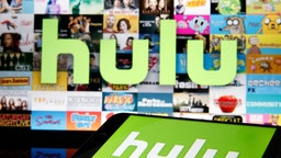 In this photo illustration, the Hulu media service provider's logo is displayed on the screen of an iPhone in front of the screen of a television showing the Hulu logo on March 28, 2020 in Paris, France. As the Coronavirus moves to the U.S., Disney has announced that it will provide a free 24/7 ABC news feed to Hulu Live to On-Demand subscribers. (Photo Illustration by Chesnot/Getty Images)