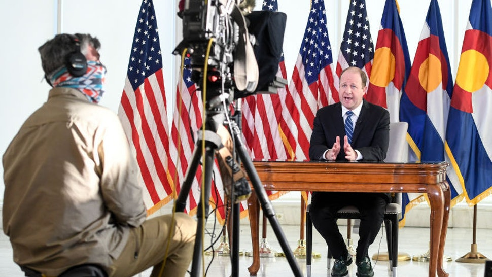 Colorado Governor Jared Polis delivers an address from the governor's mansion on Monday, April 6, 2020. Polis said that the state of Colorado will extend a statewide stay-at-home order from April 11 to April 27 due to coronavirus. (Photo by AAron Ontiveroz/The Denver Post)