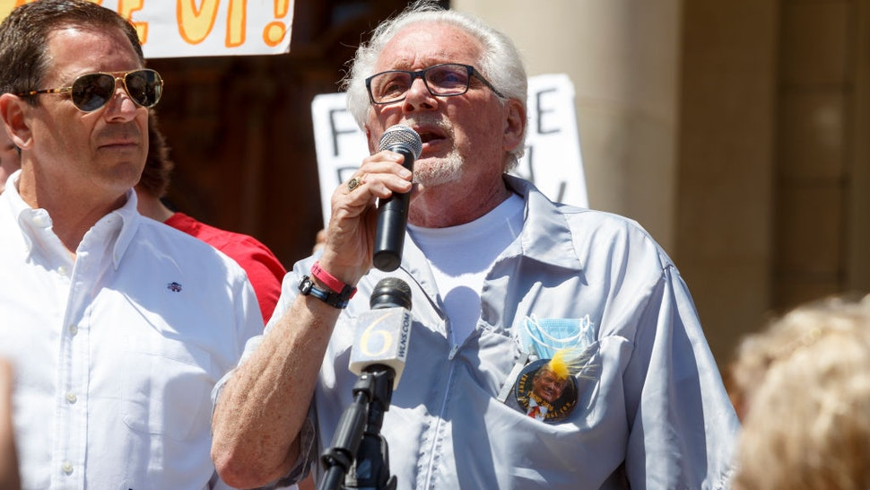 LANSING, MI - MAY 20: Owosso barber, Karl Manke, gives a speech before cutting hair for free on the steps of the state Capitol during Operation Haircut on May 20, 2020 in Lansing, Michigan. The event was a protest planned by the Michigan Conservative Coalition in response to an Owosso barber, Karl Manke, whose business license was taken away after he violated the stay-at-home order by reopening. The protest is part of a growing national movement against stay-at-home orders that are designed to help slow the spread of the coronavirus (COVID-19). (Photo by Elaine Cromie/Getty Images)