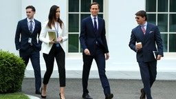 """WASHINGTON, DC - MAY 08: (L-R) Assistant to the President and Special Representative for International Negotiations Avi Berkowitz, Special Assistant to the President Alexa Henning, Senior Advisor to President Donald Trump and son-in-law Jared Kushner and White House Deputy Press Secretary Hogan Gidley walk out of the West Wing on the morning that the Labor Department announced that more than 20 million people lost their jobs in April due to the novel coronavirus pandemic May 08, 2020 in Washington, DC. """"There is a lot of heartbreak and hardship in those numbers,"""" White House Economic Council Director Larry Kudlow said."""