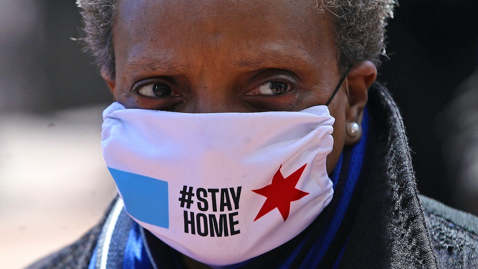 CHICAGO, ILLINOIS - APRIL 16: Chicago mayor Lori Lightfoot arrives at Wrigley Field on April 16, 2020 in Chicago Illinois. Wrigley Field has been converted to a temporary satellite food packing and distribution center in cooperation with the Lakeville Food Pantry to support ongoing relief efforts underway in the city as a result of the COVID-19 pandemic.