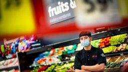 DENVER, CO - MAY, 13: Jael Marquez, 17, poses for a portrait inside the Save-A-Lot grocery store on May 13th in Denver, Colorado. Marquez works as a produce clerk at Save-A-Lot and has been working as an essential worker during the coronavirus pandemic.