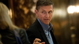 NEW YORK, NY - NOVEMBER 29: Retired Lt. Gen. Michael Flynn, President-elect Donald Trump's choice for National Security Advisor, walks through the lobby at Trump Tower, November 29, 2016 in New York City. President-elect Donald Trump and his transition team are in the process of filling cabinet and other high level positions for the new administration. (Photo by Drew Angerer/Getty Images)