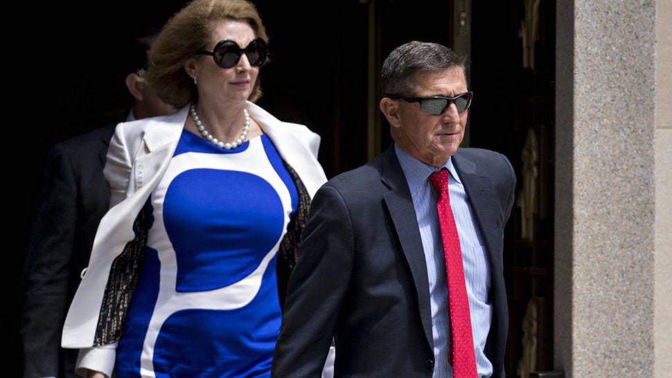Michael Flynn, former U.S. national security adviser, and lawyer Sidney Powell, left, exit federal court in Washington, D.C., U.S., on Monday, June 24, 2019. Flynn may have a singular goal in replacing his longtime criminal defense attorneys this month with the politically provocative Powell, to win a pardon from his old boss, President Donald Trump. Photographer: Andrew Harrer/Bloomberg